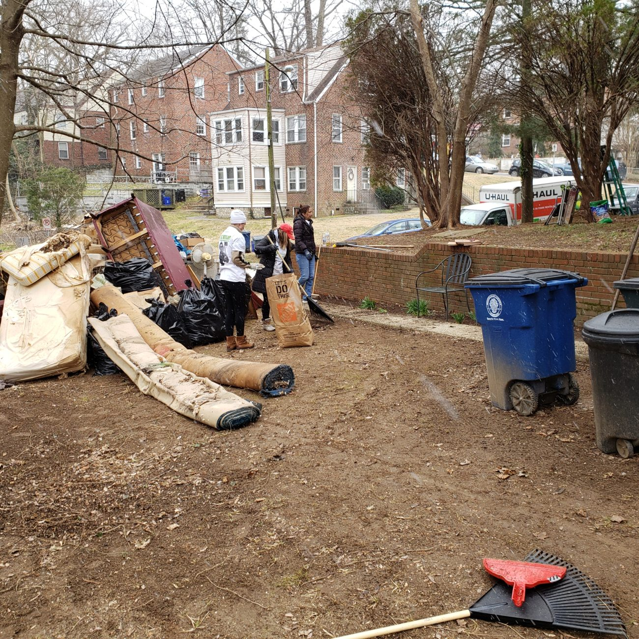 Clearing Junk and Debris During SheBuilds, a Women in Construction Event Through Rebuilding Together Montgomery County