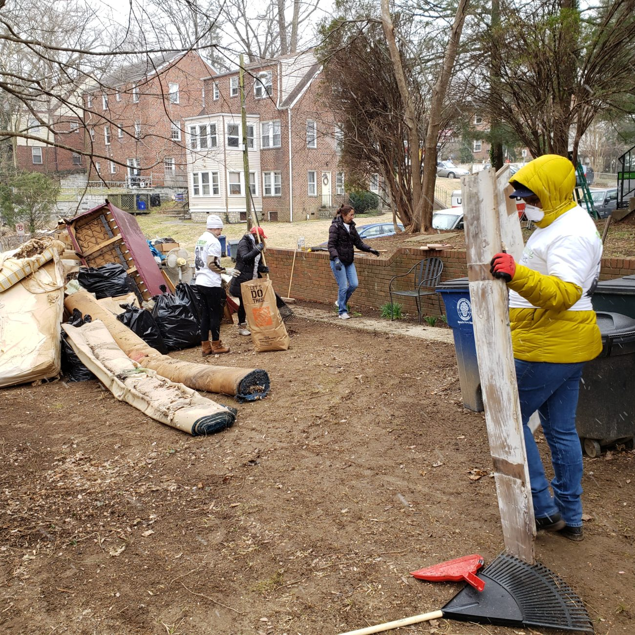 Women Construction Professionals Clearing Debris