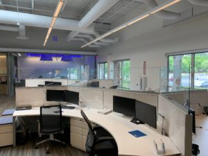 Glass cough guards that KGa installed at Turner Construction's offices. Empty, curved desks.