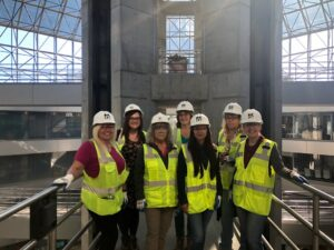 An image of some of the women in construction at Kensington Glass Arts