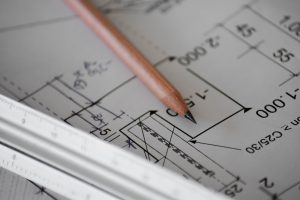 image of a pencil and blueprint